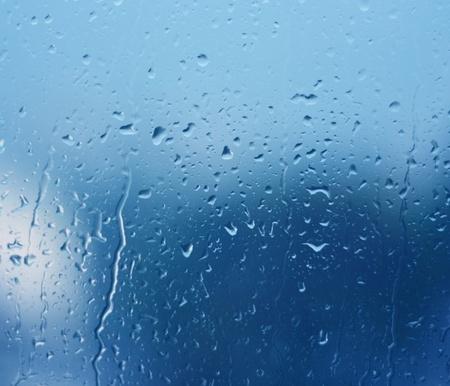 Rain drops on a window  Rain  Stock Photo
