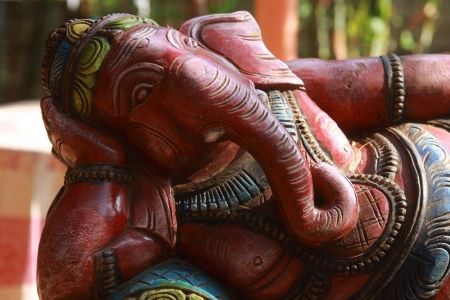 Ganecha in relaxing  Wooden Sculpture of Lord Ganesha, Hindu god of success  Photo taken in India, the State of Goa, Vagator