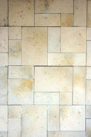 Limestone brick wall. Stock Photo