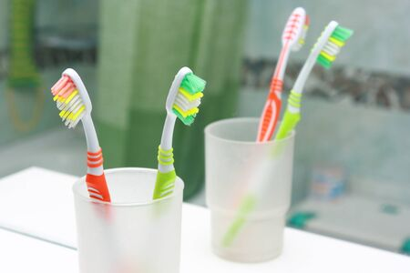 Two Toothbrushes in a bathroom  Stock Photo