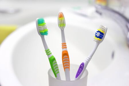Three color Toothbrushes in a bathroom  Stock Photo - 16980617