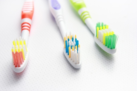 Three Toothbrushes on a shelf Stock Photo - 16980619