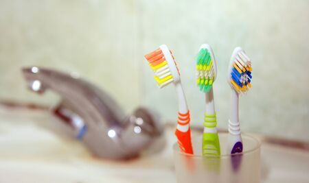 Three Toothbrushes in a bathroom Stock Photo - 17181634