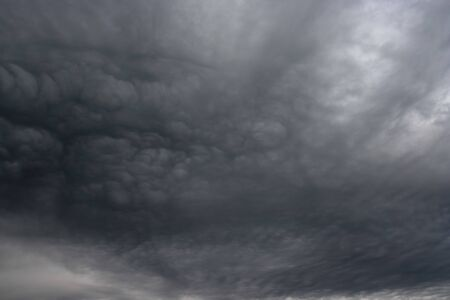 Dark ominous grey storm clouds like armagedon. The storm clouds as if Armageddon. Stock Photo