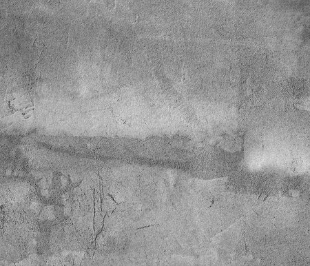 Grey concrete wall with scratches  Fragment of a old concrete wall
