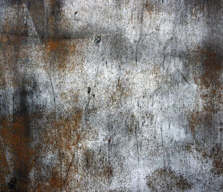 metal corrosion: A rusty old metal plate with cracked black gloss paint  Old rusty black metallic background