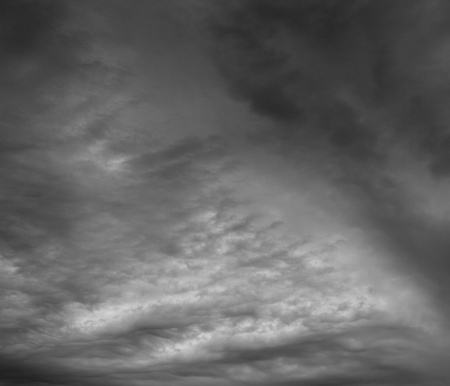 Ominous storm clouds as if armageddon. The grey storm clouds over horizon. Stock Photo