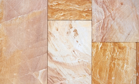 Wall from granite tiles with natural pattern. Granite with natural pattern.