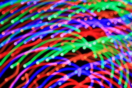 Abstract light background. Сolored lights, salute, radial beams and colour lines from centre - long exposure and zoom effect.  Stock Photo - 20117880