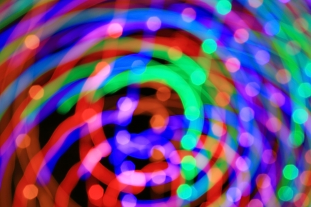 Abstract light background  Сolored lights, salute, radial beams and colour lines from centre - long exposure and zoom effect   photo