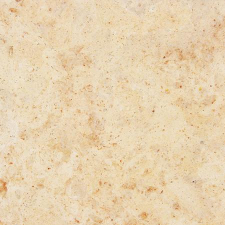 Granite background. Beige granite with natural pattern. photo