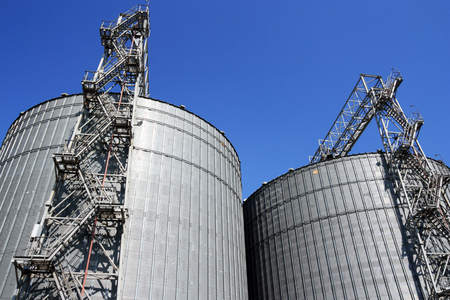 granary: Grain storage place - metal containers against sky