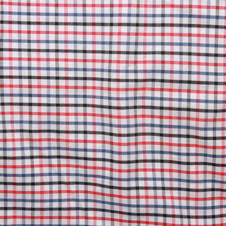 checkered picnic blanket. Striped crumpled tablecloth.