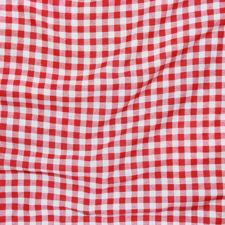 Texture of a red and white checkered picnic blanket. Red linen crumpled tablecloth. Stock Photo - 26336299
