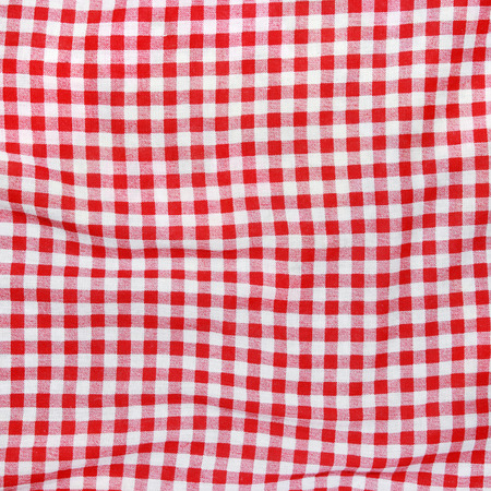 Texture of a red and white checkered picnic blanket  Red linen crumpled table cloth  Stock Photo
