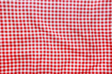 Texture of a red and white checkered picnic blanket  Red linen crumpled tablecloth