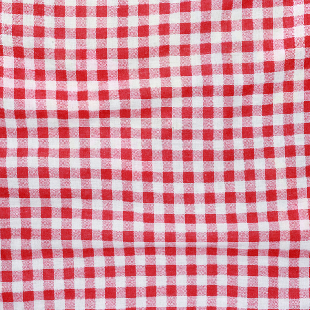Texture of a red and white checkered picnic blanket  Red linen crumpled tablecloth  photo