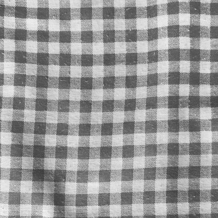 La textura de un mantel manta de picnic a cuadros rojo y blanco de lino gris arrugado