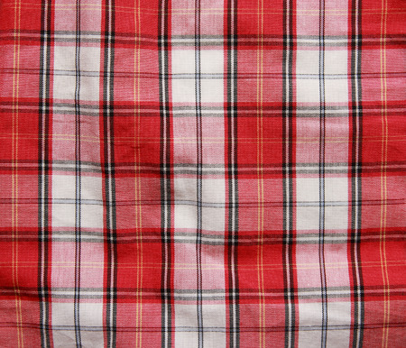 Texture of checkered picnic blanket. Red linen crumpled tablecloth.