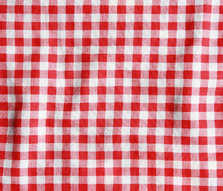 Crumple texture of a red and white checkered picnic blanket. Red linen tablecloth.  photo