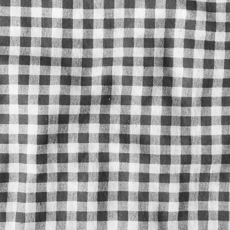 Texture Of A Black And White Checkered Picnic Blanket. Red Linen Crumpled  Tablecloth. Photo