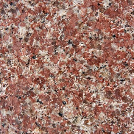 Brown granite with natural pattern. Natural granite. Stock Photo