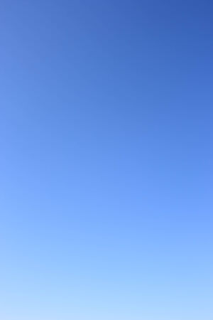 without clouds: Sky as gradient or background. Clear blue sky without clouds.