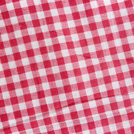 scrunch: Red linen crumpled tablecloth. Texture of a red and white checkered picnic blanket. Stock Photo