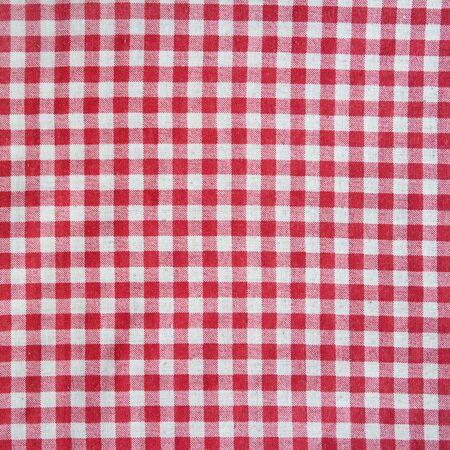 scrunch: Texture of a red and white checkered tablecloth. Red linen crumpled picnic blanket.