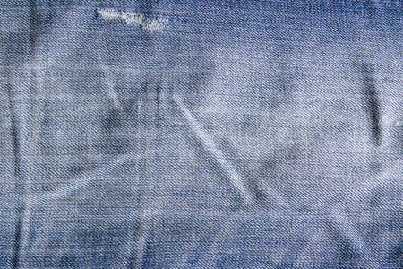 scuffed: Vintage jeans texture with scuffed. Jeans background.