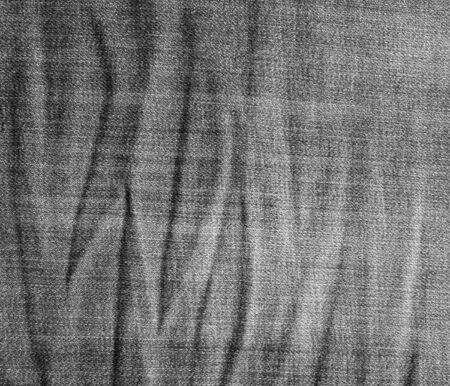 scrunch: Crumpled black jeans texture. Black jeans background. Stock Photo