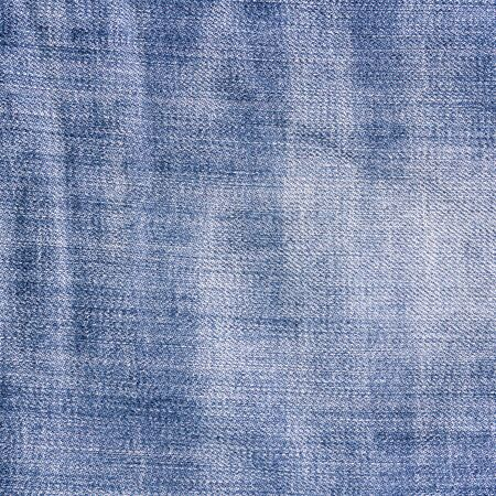 Crumpled vintage jeans background. Blue jeans texture. Stock Photo
