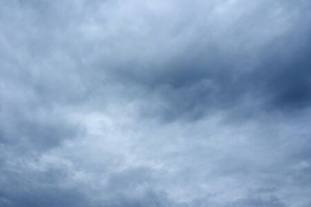 over the horizon: Rainy sky background. Stormy clouds over horizon. Stock Photo
