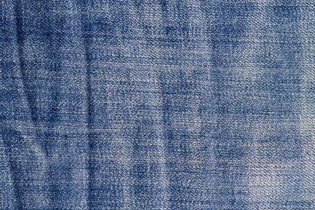 scrunch: Blue denim jeans texture. Jeans background. Stock Photo