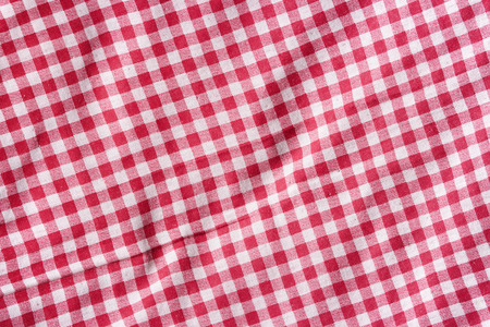 Red and white fabric texture. Red linen checkered tablecloth background.