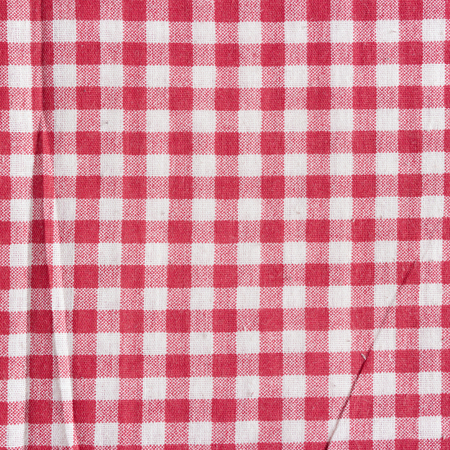 Red linen checkered tablecloth background. Imagens
