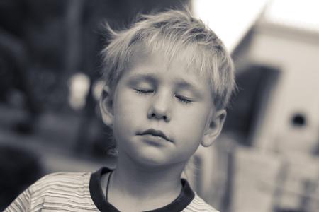 ��beautiful boy�: Dreamer. Beautiful boy, 6 years old, his eyes closed, tinted photo. Stock Photo