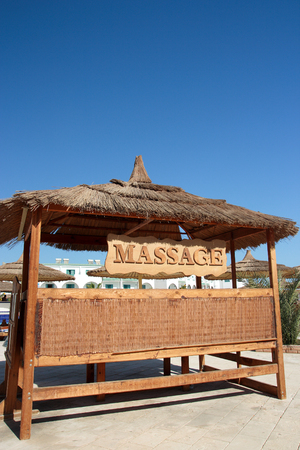 Massage place on a tropical beach. Stock Photo