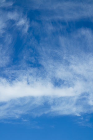 cloudscapes: Blue sky and white clouds over horizon.
