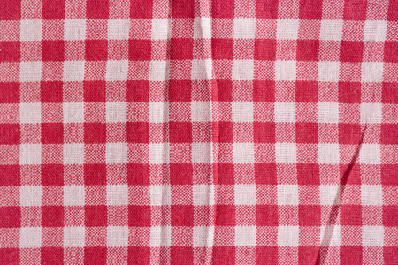 picnic tablecloth: Red picnic tablecloth background. Red and white fabric texture.