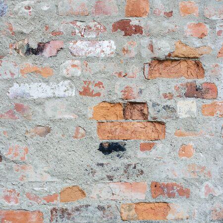 stucco: Old brick wall texture. Bricks with stucco.