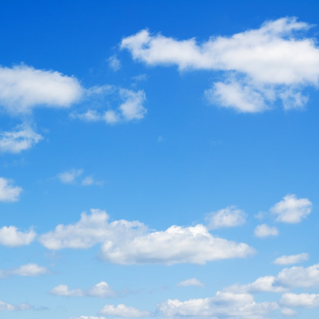 Cloudscape over horizon. Heaven. Blue sky and white clouds.