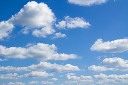 Blue sky, big and small clouds. Beautiful cloudscape over horizon. Heaven.