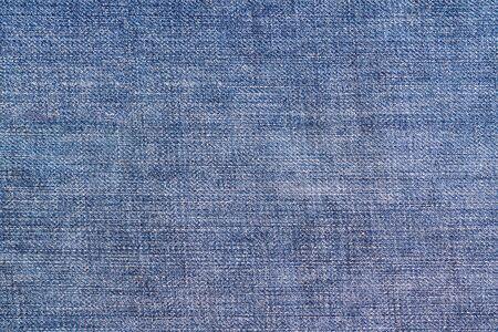 Blue vintage denim jeans background. Jeans texture.