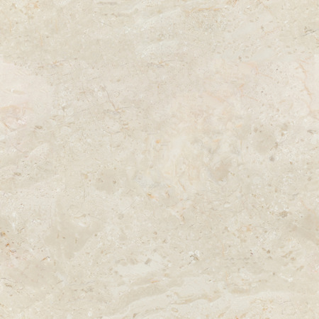Seamless beige marble background with natural pattern. Tiled cream marble stone wall texture. 免版税图像