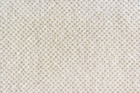 Beige carpet background, fabric close-up. Rug texture.