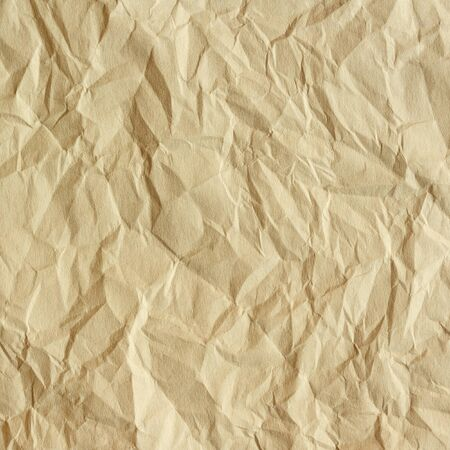 scrunch: Old crumpled paper texture. Beige paper sheet as background. Stock Photo
