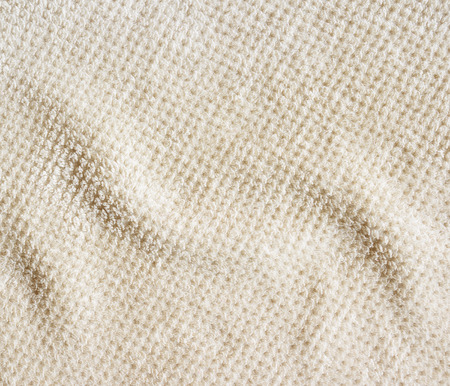 rug texture: Beige carpet background, crumpled, close-up. Rug detailed texture. Stock Photo