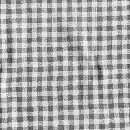 scrunch: Black and white picnic tablecloth background. Checkered fabric texture.