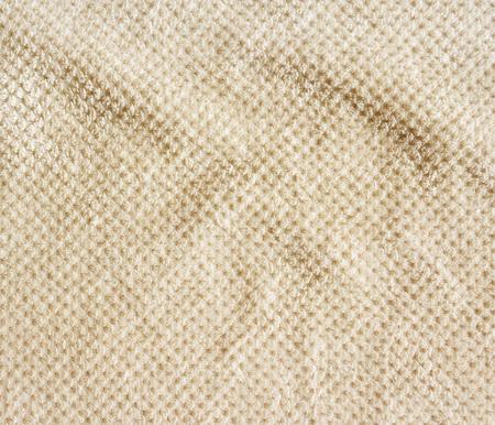 rug texture: Beige carpet background, crumpled, close-up. Rug texture, doormat.